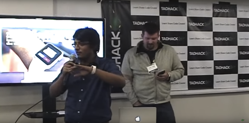 Néstor Bermudez and Arin Sime present an Apple Watch app at TADHack Chicago for detecting heart attacks and notifying loved ones