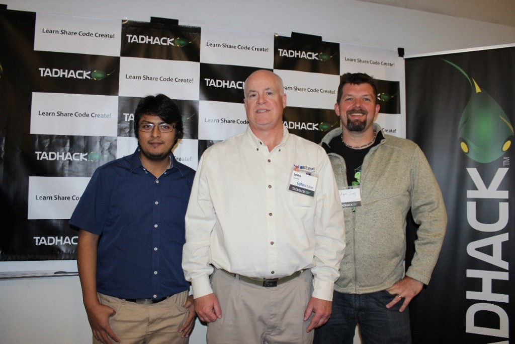 Nestor Bermudez and Arin Sime from WebRTC.ventures pose with John Senay from Telestax after winning a sponsor award from Telestax at the TADHack Chicago in October 2015